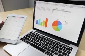 laptop showing graphs